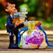 Man getting wealth/money bag